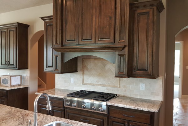 Warm wood cabinets and granite countertops