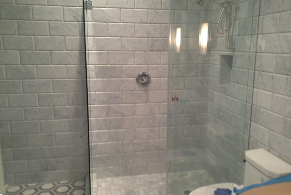 Tiled shower with glass surround