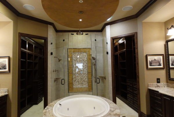 Luxurious whirlpool bath and glass door shower