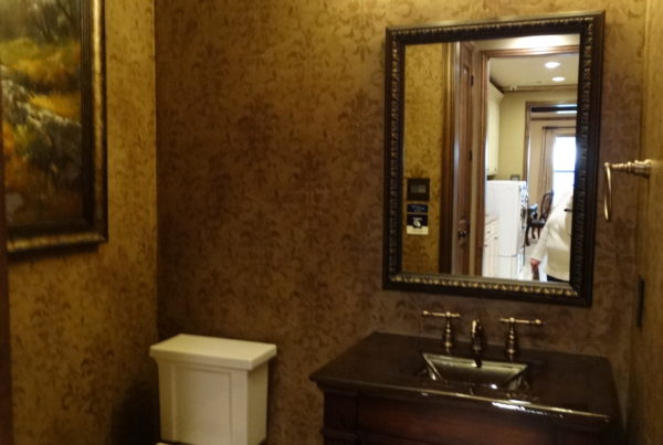 Warm wood vanity with scroll lighting