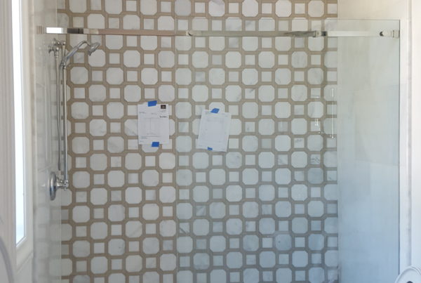 Patterned tile shower with glass door